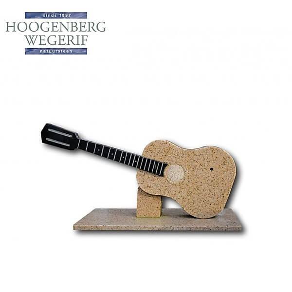 Grafsteen in de vorm van een gitaar